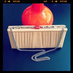 Christian Louboutin leather clutch with chain strap