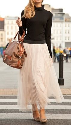 Long tulle skirt neutralized by  black top that has it's super girlyness
