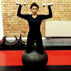 Pin for Later: Vanessa White's Workouts Are a Multitasker's Dream When She Had to Engage Her Core to Do These Shoulder Presses While Kneeling on a Stability Ball