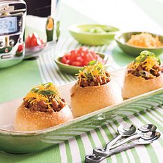 Super Quick Chili Bites  Slice tops from hearty round dinner rolls, and then let guests hollow out centers and spoon Super Quick Chili into them. Keep the chili warm in a slow cooker during the game.