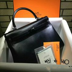 NEW So Black Kelly Box Leather Handbag 28 cm So beautiful Handbag. Bought from Europe. handcraft  Never use it. Great quality as you can see. It comes with dusk bag and Certificate but no box. Hermes Bags Crossbody Bags