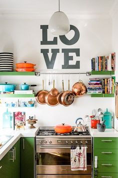 Jelly green kitchen, open shelves, copper pots, love graphic