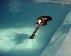 Kurt's guitar in the pool. Nirvana pool photos taken by Kirk Weddle in November of 1991.