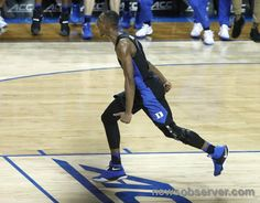 Duke's Harry Giles (1) heads back down court after slamming in two during the second half of Duke's 93-83 victory over North Carolina in the semifinals of the New York Life ACC Tournament at the Barclays Center in Brooklyn, N.Y., Friday, March 10, 2017.