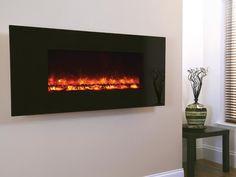 Wirral Fires Ltd trading as Fireplace Store Online - Celsi Electriflame - Black Glass Wall Mounted Electric Fire, £339.00 (http://www.fireplacestoreonline.com/celsi-electriflame-black-glass-wall-mounted-electric-fire/)