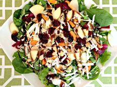 Spinach, arugula, apples, almonds, carrots, avocado, dried cranberries, white radishes, beets, chick peas and goat gouda