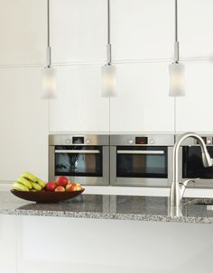 609MP-BN This mini pendant uses exquisitely designed, angled brushed nickel hardware to hold a uniquely shaped, warm glowing matte opal shade.