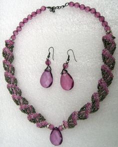 Pink and grey Czech glass and seed bead spiral necklace with a teardrop dendant
