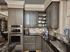 *Different cabinet doors; pretty bulkheads with crown molding over cabinets C.B.I.D. HOME DECOR and DESIGN