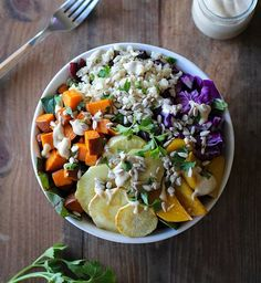 This Root Vegetable Buddha Bowls with Maple Cinnamon Tahini Dressing The Roasted Root is a best for your dessert made with awesome. Vegan Dinner Recipes, Vegetarian Recipes, Healthy Recipes, Healthy Meals, Vegetable Salad, Vegetable Recipes, Veggie Food, Veggie Dishes, Sin Gluten