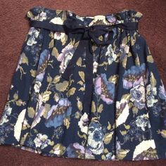 LC Lauren Conrad blue floral print cotton skirt LC Lauren Conrad blue floral print cotton skirt size large! BNWT. Super comfortable and stretchy! Made of 76% cotton, 3% spandex and 21% polyester. Has a super stretchy elastic waist band and is topped off with a bow belt, can be worn with or without! 19 inches long and the waist is 16 inches laying flat!         REASONABLE offers accepted ❌No trades! LC Lauren Conrad Skirts Mini
