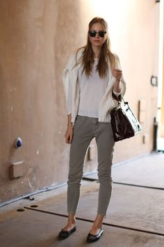 Basic White Tee, gray trousers, black ballet flats, paired with a white sweater vintage glasses and an oversized black leather hand bag