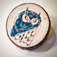 From slices of wood with pin attached to back. I could make these... I have the colored sharpies already! Hmm, maybe a kid craft...