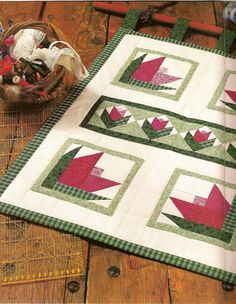 Table runner -- photo tutorial including templates for these paper pieced flowers.