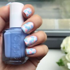Get festive with this pastel blue, pink and green nail art.