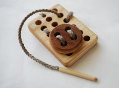 "wooden toy for ""sewing"""