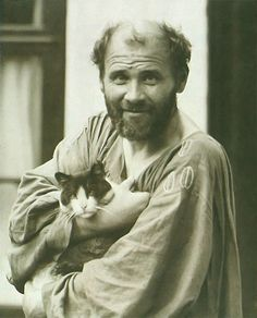 Artist Gustav Klimt and his loyal cat :)  Klimt was known for keeping large droves of kitties around his studio not just for the company, but also because he firmly believed that feline urine was the best available fixative for his drawings! The more you know…