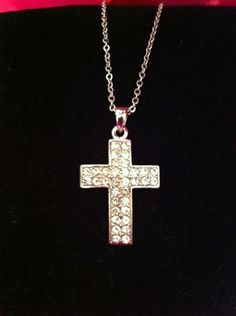 Sometimes a simple cross can make a profound statement... especially when it's covered in crystals!
