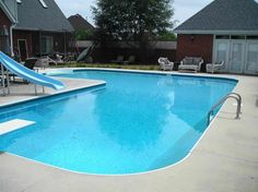 Simple Inground Pool Designs simple inground fiberglass pool with marble paving and living outdoor areas L Shaped Inground Pool