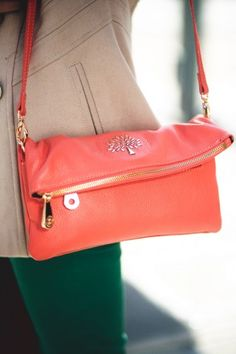 Love at first sight. Manita Singh's Mulberry is the cutest little portable clutch. Crushing on the salmon hue, too.