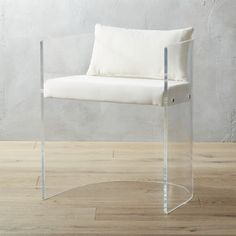 "Shop antonio acrylic chair with pillow.   This show-stopping chair has a high-end vibe you can't match for the price.  Designed by Ceci Thompson, the graceful curve of the back holds a special allure––""it feels quite luxe, but also has a vintage appeal."