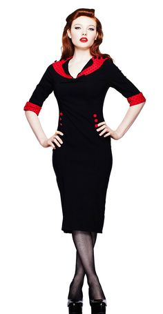 A black bengaline pencil dress with red polka dot collar. Three black contrast buttons decorate the collar. Detailed with a black bengaline bow on the front of the dress. This 3/4 length sleeved dress has red and black polka dot contrast cuffs. Six red covered buttons can be seen on either side waist with black contrast buttons featured on the back of the collar.