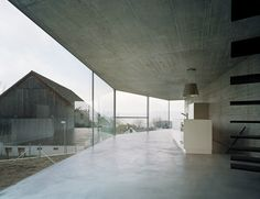Crooked concrete wall divides Zurich building by Christian Kerez into semi-detached homes