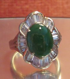 "Estate Vintage Designer Natural Green Jade Jadeite Diamond 14k Solid Yellow gold Statement Ring Jade is known to bring good luck and fortune! Refractive index shows that this green jadeite is natural and with Chelsea filter shows No Treatment. Signed 14k Yellow gold Stamped ""Designer Hallmark & Designer Trademark"" Size 5 Resizable The Focal Natural Mined Oval Shape Green Jade measures approx. 11mmx8.65mm, Highly Desirable Imperial Green Color, Excellent smooth Luster & Sheen"