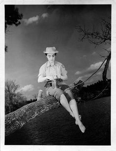 Elsie P. Lanard, East Providence, Rhode Island, WAC Medical Company, baiting the hook while fishing near Camp Patrick Henry, Virginia 1945
