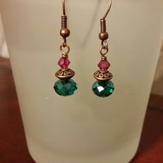 Beautiful emerald and fushia colored Swarovski crystals with a carved copper bead. Small drop earring with big bold colors. Bright tropical earrings perfect for wearing with a summer sundress