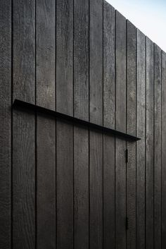 Eastwest Architecture adds charred-cedar gym to garden of east London home
