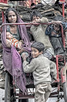 they seem to be carrying wood for CREMATION or for their own abode Loha Pul Delhi Kids Around The World, People Of The World, Around The Worlds, Poverty Photography, Children Photography, Poor Children, Precious Children, Mundo Cruel, World Poverty
