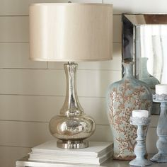 Simply stunning, this glass table lamp features a silver and gold crackled, metallic finish that& paired with a chrome metal base and round hardback fabric shade. Glass Table Lamp, Rustic Table Lamps, Lamp Design, Modern Table Lamp, Table Lamp, Farmhouse Style Table, Rustic Lamps, Farmhouse Lamps, Farmhouse Table Lamps