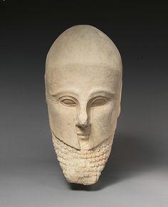 Limestone bearded head with a Corinthian helmet; early 5th century B.C…