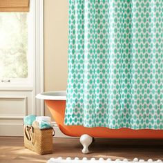 orange tub great combination, add in some colorful, scentiful Vitabath Products and you've got a great bathroom!