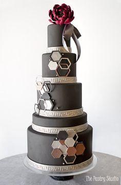 contemporary black 5 tier wedding cake with geometric trim silver greek key by the pastry studio