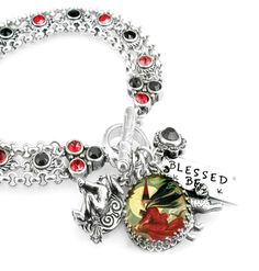 Witchy-Boo is flying your way on her broomstick. What a great halloween charm bracelet with lots of bling all year round. Ruby and Jet Swarovski crystals adorn the bracelet chain, vintage image of a f