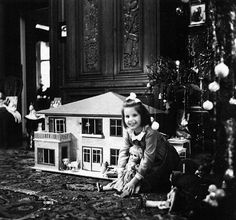 German girl with her presents on Christmas morning (1942)..one present a beautiful doll house.