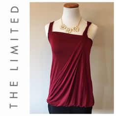 The Limited Burgundy Sleeveless Top Preowned   in great condition   worn 2-3 times only  great with a skirt, jeans or pants   made of polyester and spandex blend. The Limited Tops
