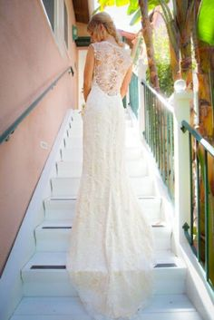 Lace Back Wedding Dresses - A long trail  adds to the royal feeling that this lace back wedding dress exudes.