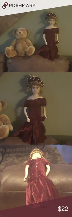 Porcelain doll An 18 inch doll wearing a velvet dress with bow 1 foot is broken but hidden by length of dress none  Other