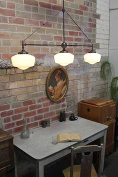 Glass chandelier has that authentic vintage look. The schoolhouse glass shades come in an opal finish which are supported by the quality brass chandelier fixtures.