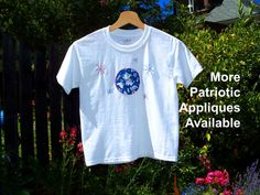 Kid's T-Shirt with applique in your choice of patriotic fabrics.  Finished with embroidered fireworks in red and blue mixed with silver thread.  2T, 3T, 4T, 6-8, 10-12, or 14-16 years.  $20, great for 4th of July