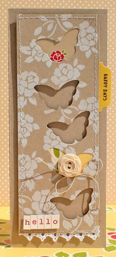 Lovely Brown Kraft Card...with butterfly punchouts & white flowers.