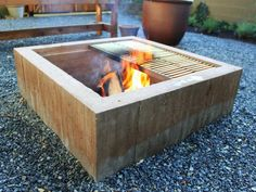 DIY concrete fire pit...rough form boards and an airy concrete mix give it the perfect surface texture.