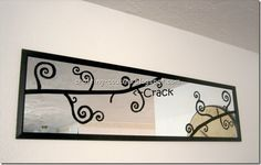 Blogger cracked a mirror. Used electrical tape to hide the crack and then a stencil to add curly-qs. Not a bad idea.