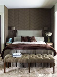 "The palette in the upstairs master bedroom comes straight from nature: ""You're in the treetops — spruce, pines, oaks, and maples,"" Veltman says. The headboard and bolster are covered in celadon Knoll velvet, and the tufted bench is upholstered in smoky Pindler & Pindler linen, which also covers the chevron panels in the niche.   - HouseBeautiful.com"