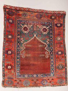 Konya prayer rug first half 19th century exhibited by DeWitt Mallary. Rugs and carpets on display at Sartirana Textile Show