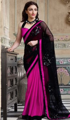 Spice up your looks as soha ali khan in this black and pink color net satin half n half sari. The lace and sequins work seems to be chic and aspiration for any event. #partywearsari #partylooksaris #bollywoodsarees