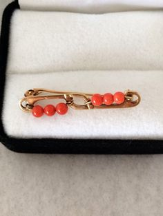 A personal favorite from my Etsy shop https://www.etsy.com/listing/234150453/antique-coral-18k-gold-750-coral-bead